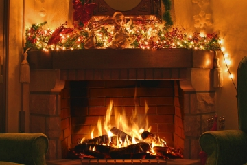 Decorating your fireplace with logs this Christmas